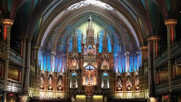 A majestic basilique with handcrafted, intricate woodwork and a palette of colors